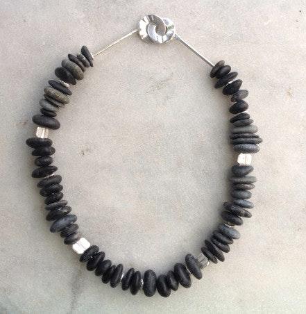 Bundles of black stones
