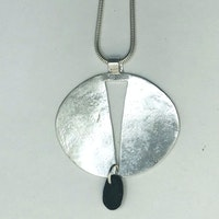 Oval Silver Pendant with Black pebble