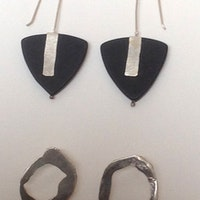 Triangular slate with silver bar and organic circle