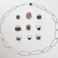 Hammered silver chain and collection of silver rings